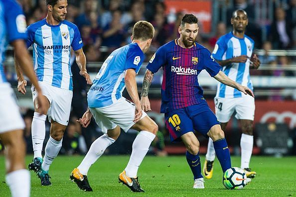 Malaga managed to stifle Messi but couldn't stop Barcelona