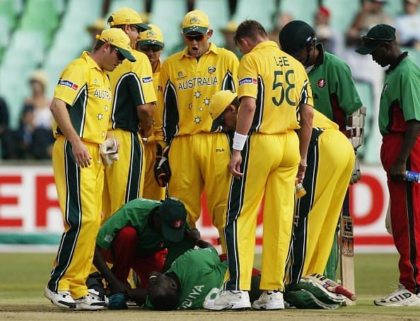 Kennedy Obuya of Kenya lies on the ground after being hit and bowled by Brett Lee of Australia