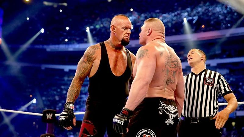 Undertaker and Brock Lesnar staring each other down at WrestleMania XXX