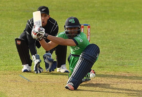Debutant Simi Singh plays a sweep shot as New Zealand wicketkeeper Luke Ronchi watches