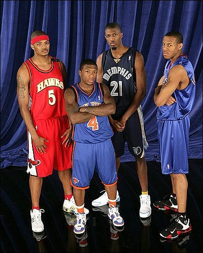 Nate Robinson (Center) and Andre Iguodala (Right) as participants of the 2006 Slam Dunk Contest.