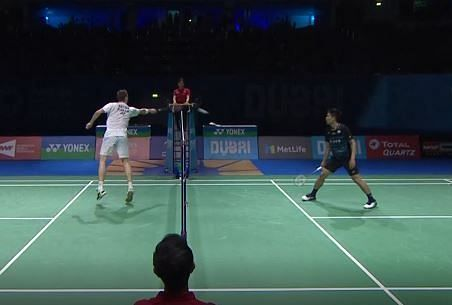 Axelsen touching the net with
