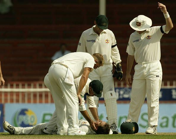 Justin Langer is hit by the ball