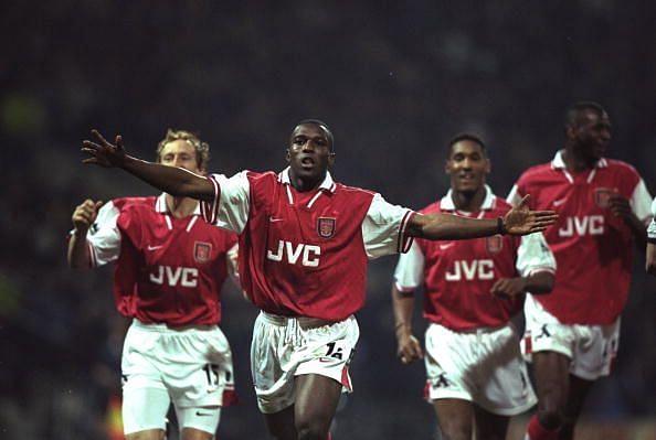 31 Mar 1998:  Arsenal striker Christopher Wreh celebrates scoring the winning goal