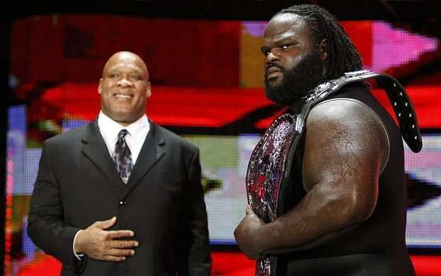 Mark Henry holding the ECW Championship with his manager at the time Tony Atlas by his side