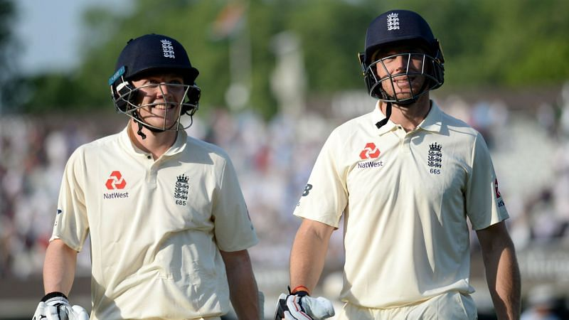 Dom Bess and Jos Buttler walk off for England