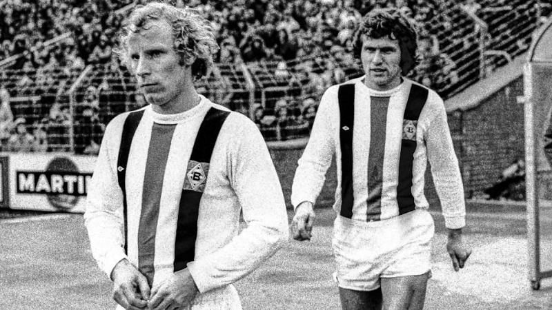 Jupp Heynckes (right) slots in as a Gladbach player alongside Berti Vogts (left); [Via: Bundesliga.com]
