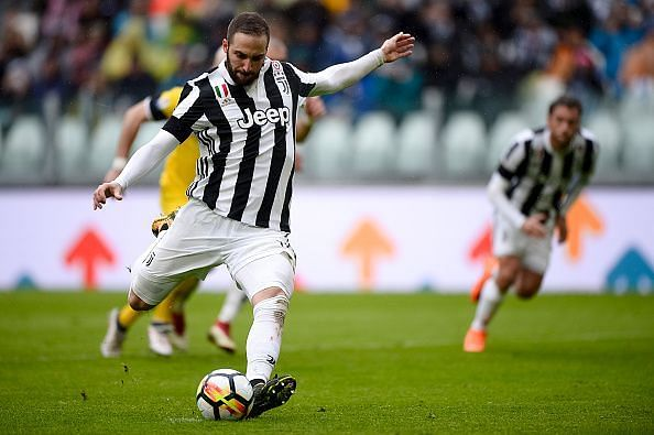 Gonzalo Higuain of Juventus FC fails to score a penalty kick...