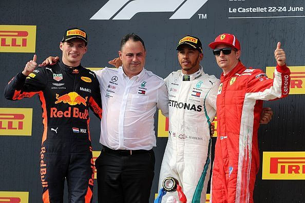 Top three finishers Lewis Hamilton of Great Britain and...