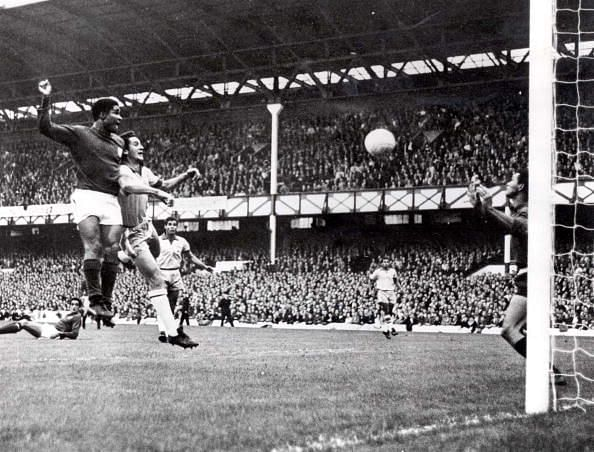 World Cup Finals, 1966. Liverpool, England. 19th July, 1966. Portugal 3 v Brazil 1. Eusebio of Portugal (L) beats Brazil