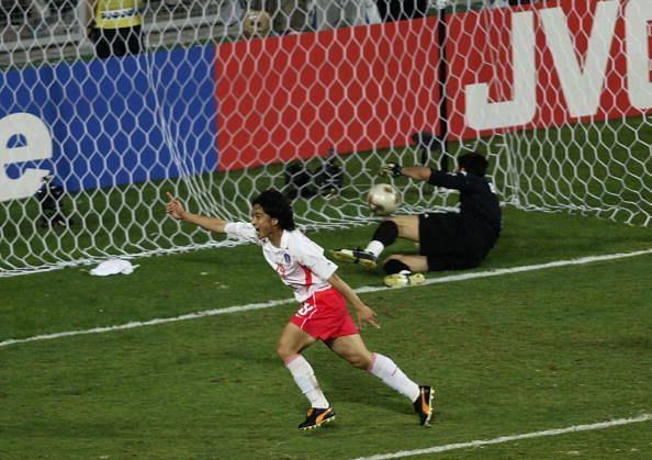 Jung Hwan Ahn of South Korea heads the winning goal past goalkeeper Gianluigi Buffon of Italy