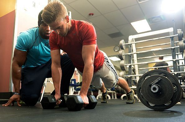 Nick Miller works out with personal trainer Nick Natt as he trains for a firefighting position.
