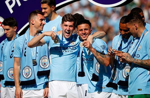 Manchester City players celebrating.