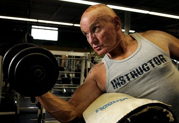SENIOR WORKOUT.05.22.2007.70-year-old bodybuilder David Smith performs a biceps curl at Reflex Fitne