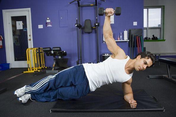 April 26 2007 Toronto: Start exercise 2: Twisting Side Plank. Alex Savva of CircuitFit shows three e