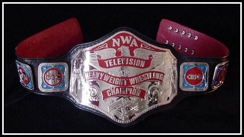 The original NWA World Television Championship, rendered in silver to rather than gold.