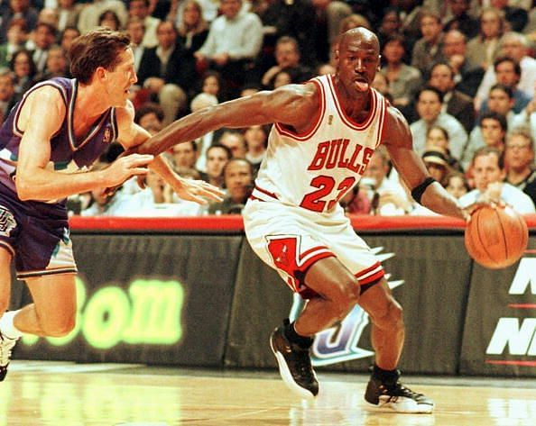 Chicago Bulls player Michael Jordan sticks out his