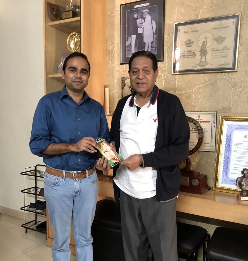 Author presenting his book to Chandu Borde