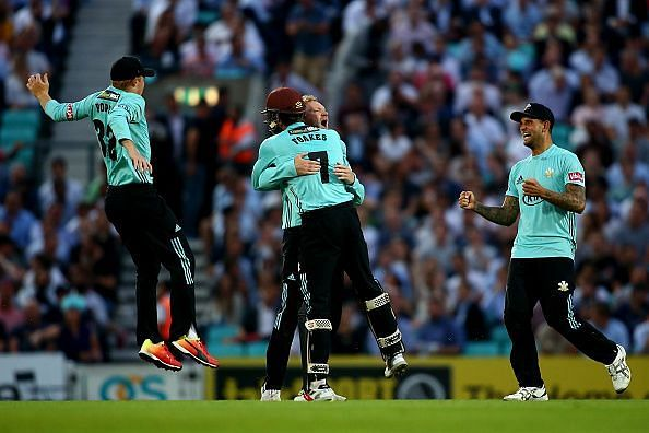 Surrey players in delight at the end of their first win