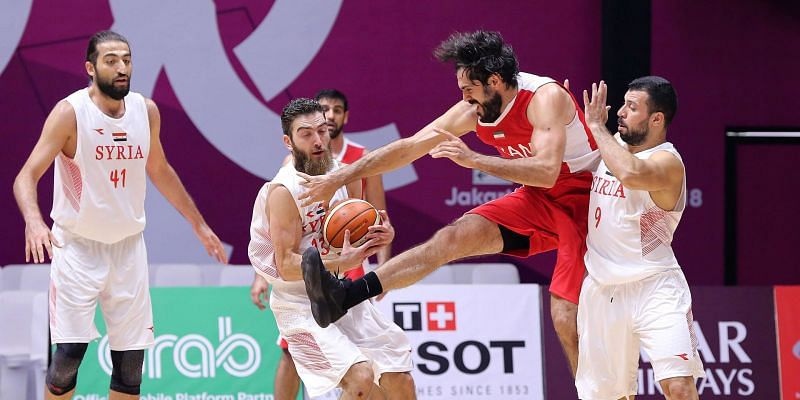 Action from Chinese Taipei and Qatar Basketball at the Asian Games on Day 10
