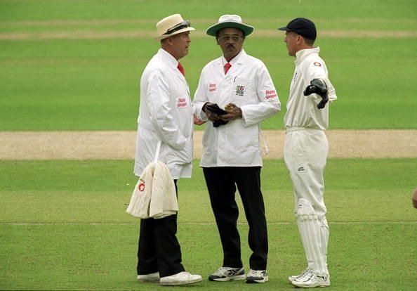 Alec Stewart confers with the umpires during a Test match