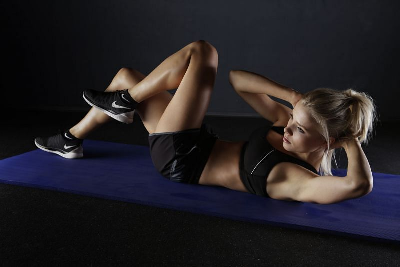 Bicycle crunches tone the abs and obliques