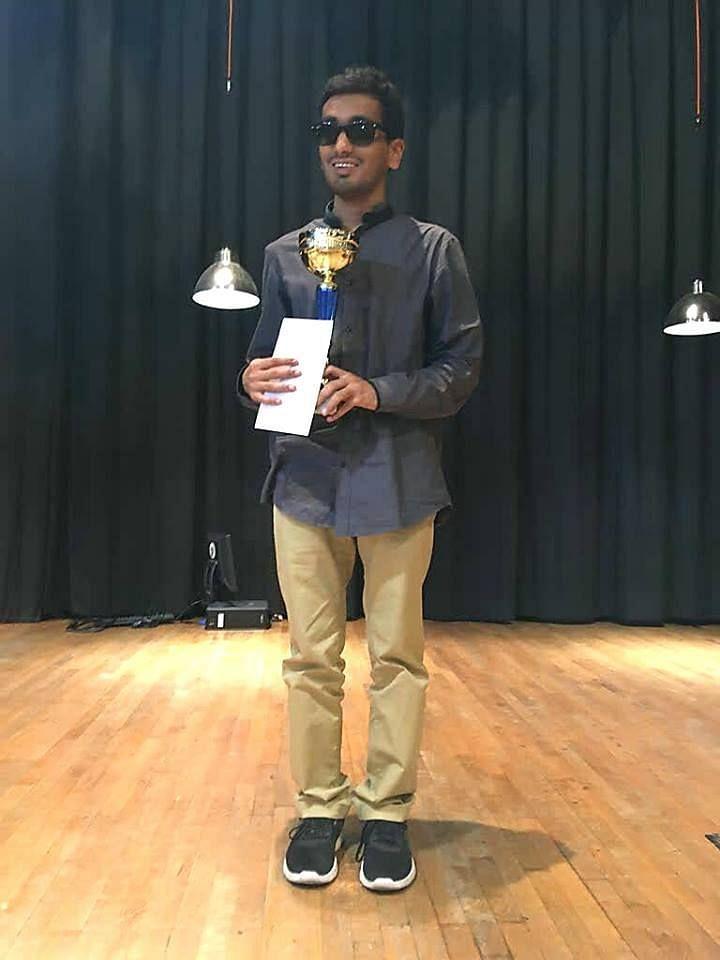Darpan Inani with his big prize.