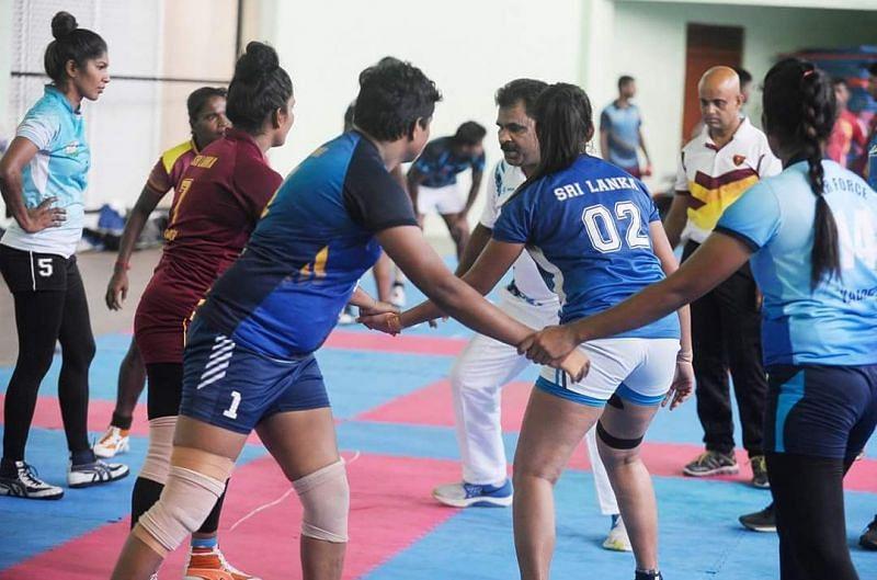 Udaya Kumar training the women