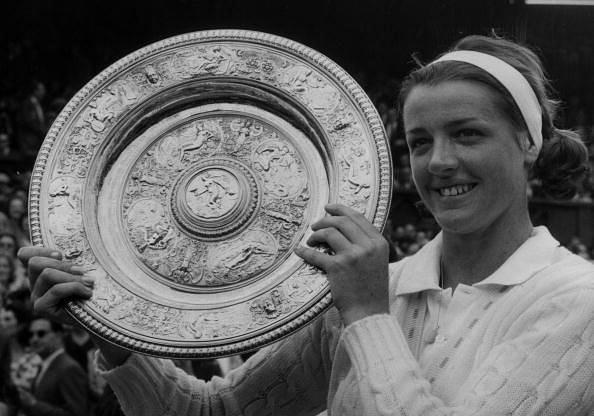 Margaret Court lifts the Wimbledon trophy