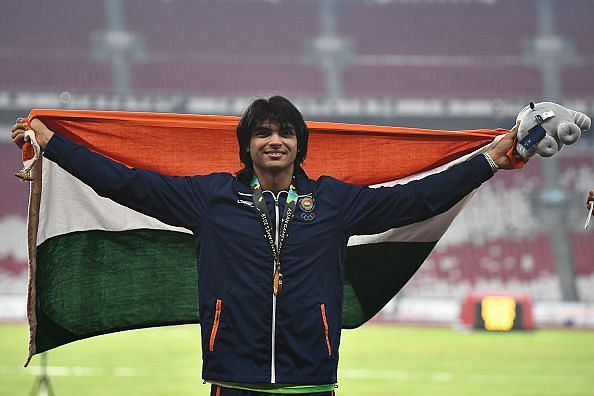 Neeraj Chopra celebrates his Asiad gold medal on the podium