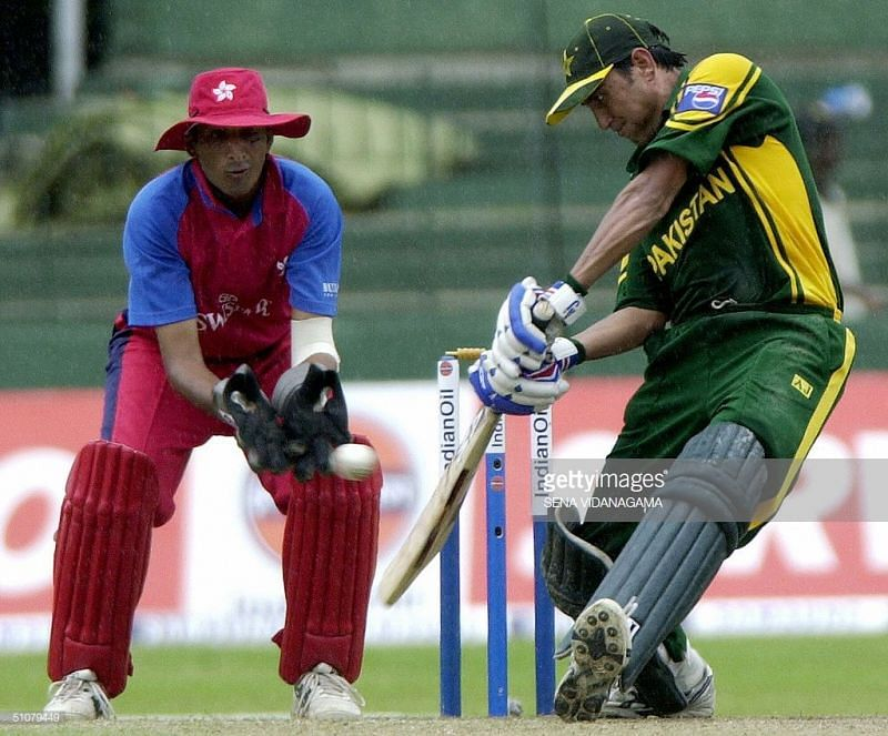 Younis plays a shot against Hong Kong
