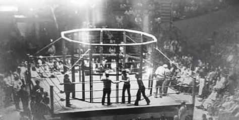 The first wrestling steel cage, made of chicken wire.