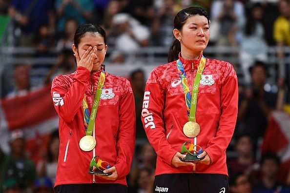 Misaki Matsutomo (left) and Ayaka Takahashi after receiving their Rio Olympic gold medals