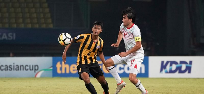 Tajikistan goalscorer Ehson Panshanbe in action against Zahril Zabri of Malaysia (Image Courtesy: AFC)