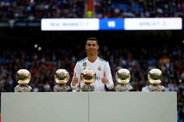 Ronaldo poses with his 5 Ballon d