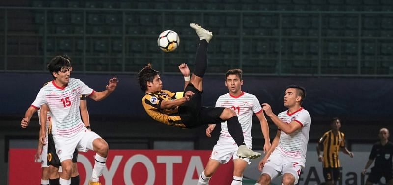 Malaysia earned a credible draw against Tajikistan to keep their qualification hopes alive (Image Courtesy: AFC)
