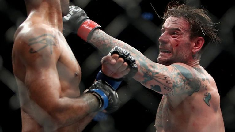 CM Punk throws a left hook in his last fight against Mike Jackson at UFC 225