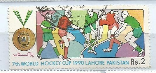 A STAMP ISSUED BY PAKISTAN IN 1990 ON 7TH WORLD CUP HOCKEY