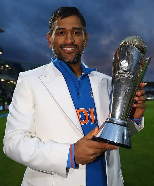 DHONI WITH 2013 CHAMPIONS TROPHY