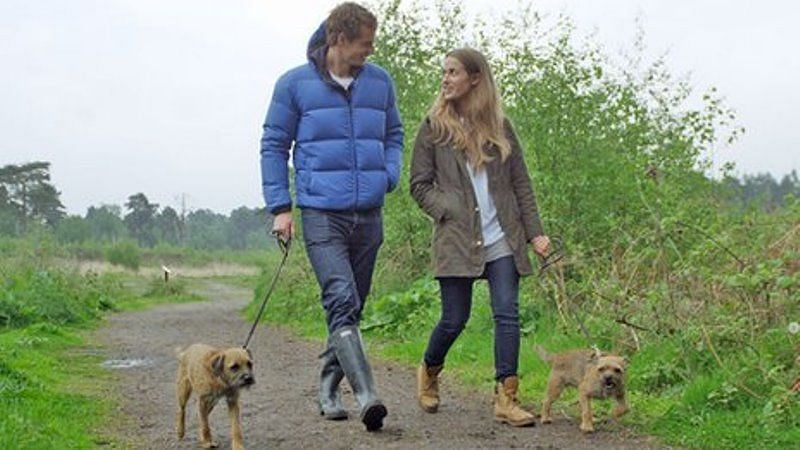 Murray and his wife Kim Sears taking their dogs out on a walk