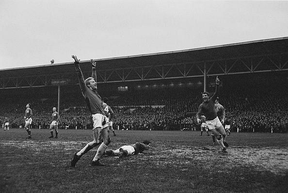 Denis Law - 1964 Ballon d'Or Winner (Left) scoring for Manchester United