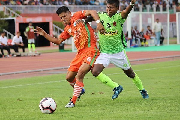 Abhishek Das (right) of Gokulam Kerala FC goes for a tackle on Ashok Moirangmayum of NEROCA FC