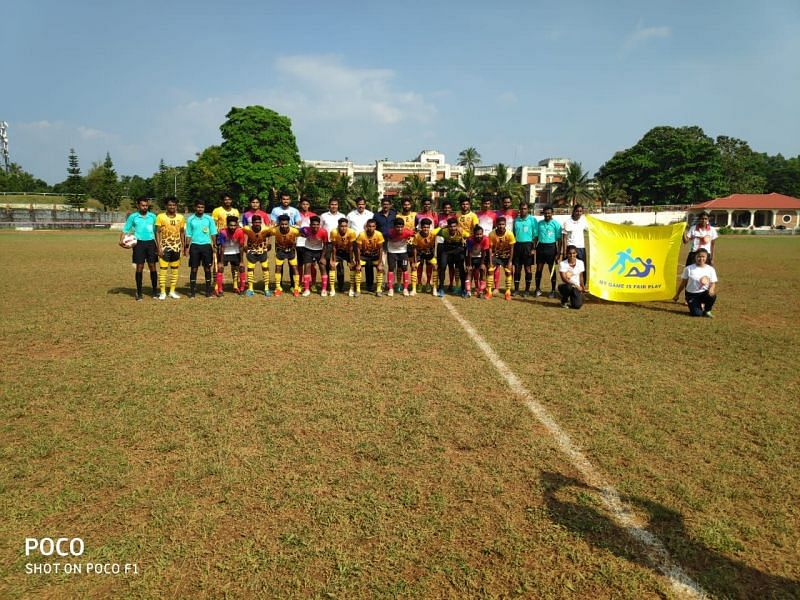 Teams posing for the picture along with officials ahead of the match.