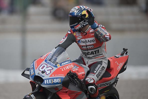 Italian bike racer Andrea Dovizioso Sunday made a frantic win in the restarted Valencia MotoGP race that was disrupted by rains