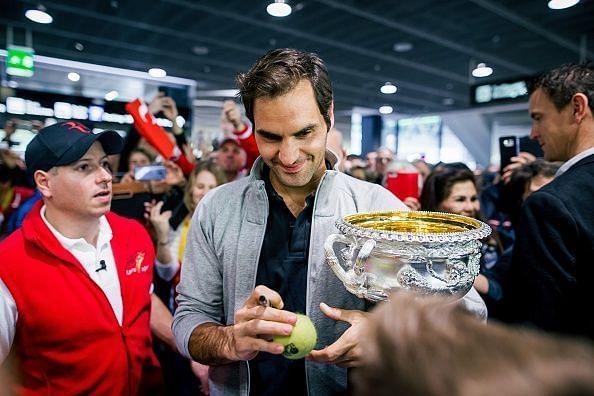 Roger Federer with the 2018 Australian Open trophy