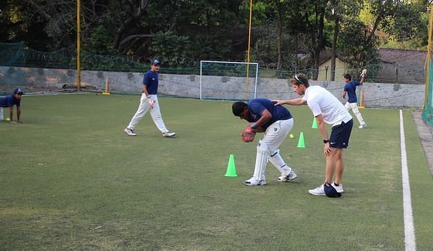 Middlesex first team wicketkeeper, John Simpson instructing wicket-keepers at the camp