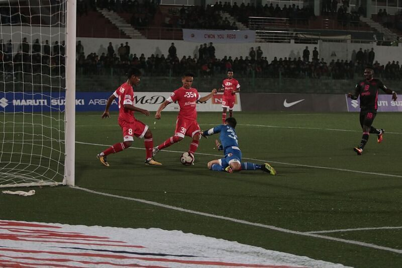 The defenders and the goalkeeper lacked communication between them.