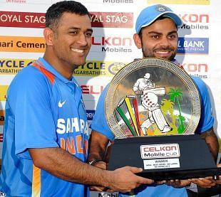 Image result for dhoni sends virat to collect celkon cup 2013 trophy