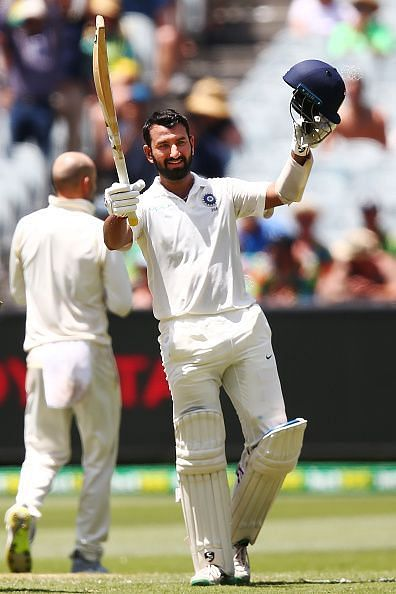 Cheteshwar Pujara celebrates after scoring his century