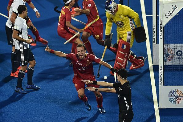 Spanish players rejoice after scoring a goal against France at the 2018 Hockey World Cup